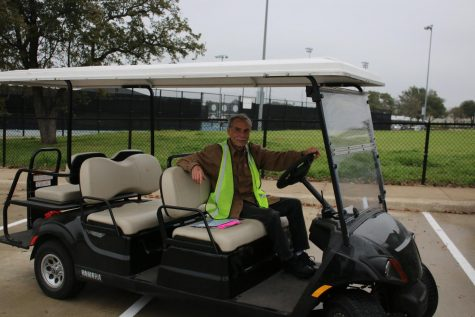 Parking attendant Kevin Montague patrols the lot during third block.
