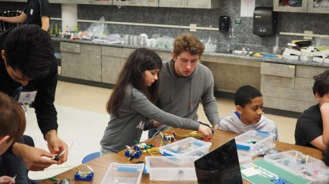 Junior Ryan Anderson teaching an elementary student about circuits.