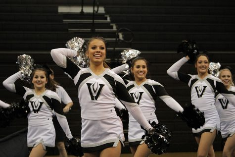 The cheer team performs a showoff in the gym on Jan. 13 before their UIL contest