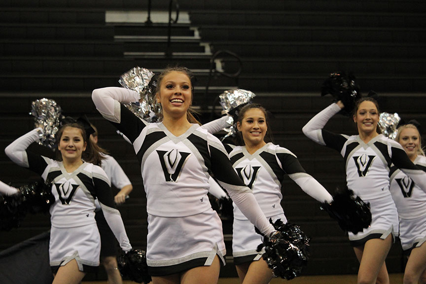 The+cheer+team+performs+a+showoff+in+the+gym+on+Jan.+13+before+their+UIL+contest