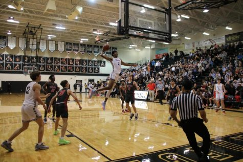 Senior Greg Brown goes in for a dunk to help win 63 to 46 against Vista Ridge.