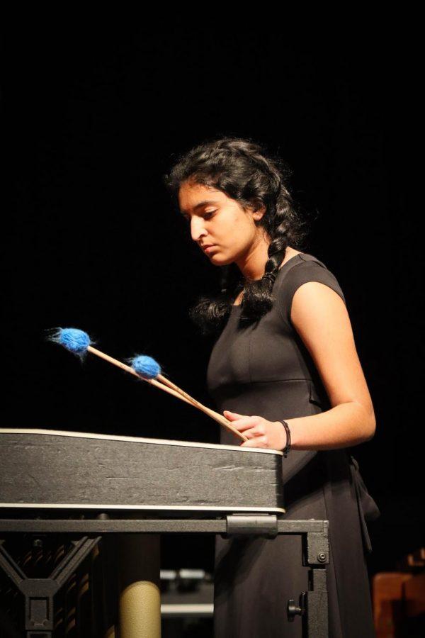 Freshman Neha Ramachandran preforms in the opening Symphonic ensemble piece.