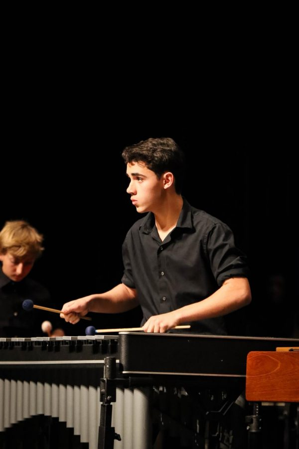 Sophomore Nick Silva performs an ensemble piece on the vibraphone. Silva multitasked playing and watching the conductor to ensure that the piece didn't fall apart.