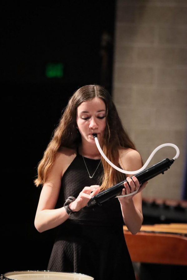 Junior Kylie Bryan plays the melodica, a handheld piano, in a Wind Ensemble piece.