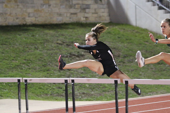"Sophomore Sara Pacheco participated in the Viper Relays and ran the varsity girls 100m hurdles while balancing cheer. ""[Hurdles] is something different,"" Pacheco said. ""I enjoy running but I wanted to find something that would be different than just typical running."""