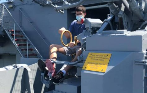 The author, Nicholas Scoggins, playing with one of the USS Lexington's 5 inch guns.