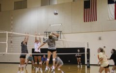 The VHS Volleyball team practices while wearing masks to stay safe during the pandemic.