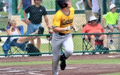 Sophomore baseball player Brayden Buchanan runs towards base from home plate.