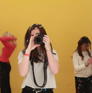 Photographer and videographer Laura McClintock takes a shot on her camera.