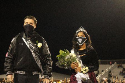 Valluru and Hartman stand in shock amidst cheers as their homecoming court win is announced.