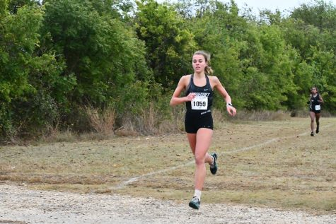 Senior Gemma Goddard runs through the Old Settlers Park course in Round Rock  at the district meet Oct. 27.