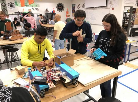 Riley Galligher, far left, works with her robotics team as a project manager.