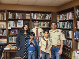 Jalwal poses for a picture with has parents and siblings after becoming an Eagle Scout.