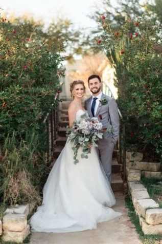 Alex Lutz and Elise Lutz pose for a picture during their wedding.