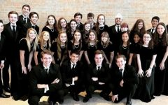Galligher and Connors standing with their choir family at the region competition last year