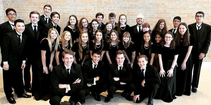 Galligher+and+Connors+standing+with+their+choir+family+at+the+region+competition+last+year