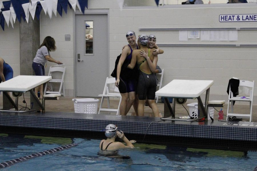 Girls on the 200 free relay react to placing third.