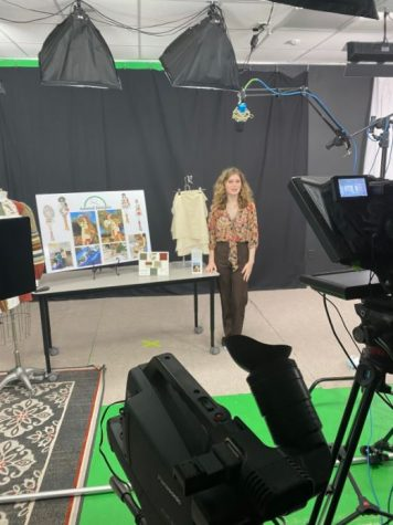 Audrey Kimball filming her fashion design presentation for the judges