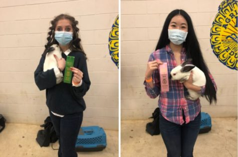 Lenora Vancini and Rachel Yang holding their rabbits and awards at the FFA show