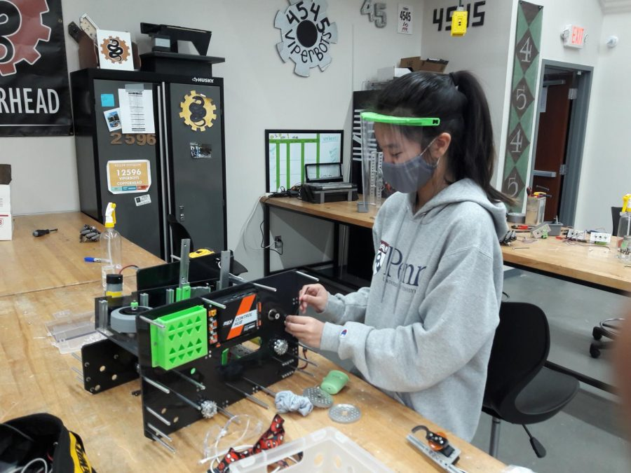 Caitlyn Hsieh works on building the robot for the FTC 4545 ViperBots team.