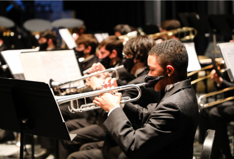 Trumpet players from the wind ensemble perform at the concert portion of the competition