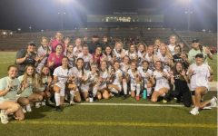 The girls soccer team after winning the 6th game of the playoffs.
