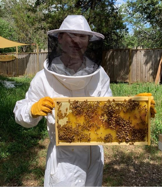 Alexander Beaucamp, who took first place at the Entomology Area competition, with the bees he takes care of at his home.