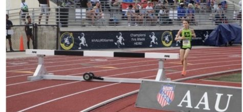 Garrett gets ready to jump over the hurdle in one of her laps at the National Junior Olympics
