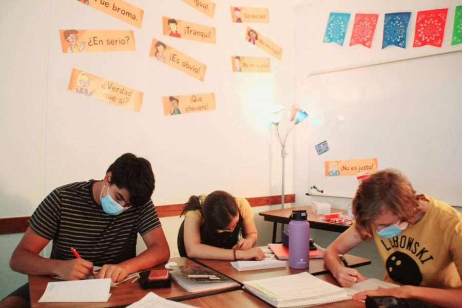 Students in Spanish class getting back into assignments for the school year.