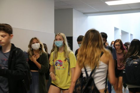 Students walk through the halls during a passing period.
