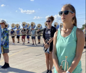 Students ready in the heat of the summer to practice playing and marching. Photos by Isabela Rotendaro