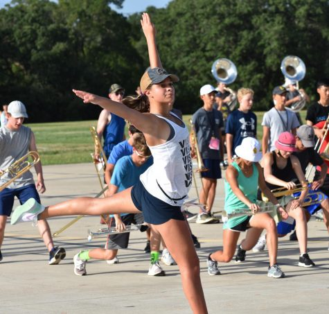 Vision dancer Ava James performs choreography during summer band practice.