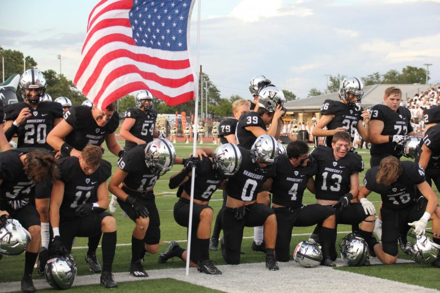 Varsity football players ready to give it all the first game and take home a win