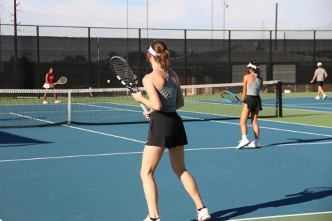 Two of the varsity tennis girls getting ready to go up against Belton in their match