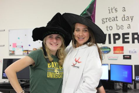 Seniors Karissa Gonzales and Taylor Chronert dress up for Twin Day together by wearing witch hats.
