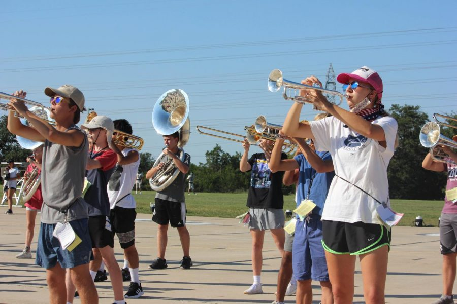 Members of the high school band practice amidst the lifting of COVID restrictions.